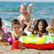 Child group have fun and play with beach toys — Stock Photo #5867253