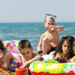 Child group have fun and play with beach toys — Stock Photo #5867342