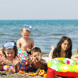Child group have fun and play with beach toys — Stock Photo #5867370