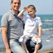 Stock Photo: Happy father and son have fun and enjoy time on beach