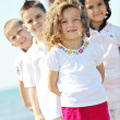 Happy child group playing on beach — Stock Photo #5867865
