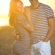 Happy young couple have romantic time on beach — Stockfoto