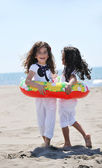 Happy child group playing on beach — Stock Photo