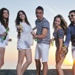 Group of young enjoy summer party at the beach — Stock Photo #5870151