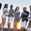 Group of young enjoy summer party at the beach — Stock Photo #5870152