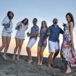Group of young enjoy summer party at the beach — Stock Photo #5870155