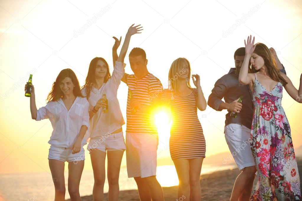 Group of young enjoy summer  party at the beach on beautiful sunset — Stock Photo #5870031