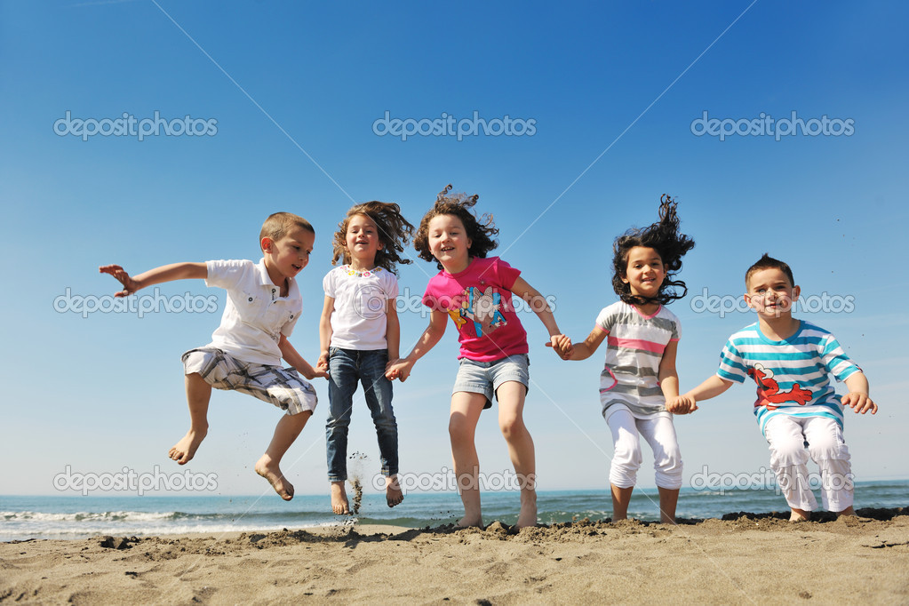 Group of happy child on beach who have fun and play games — Stock Photo #5870164