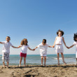 Happy child group playing on beach — Stock Photo #5969275