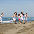 Happy child group playing on beach — Stock Photo #5969339