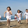 Happy child group playing on beach — Stock Photo #5969392