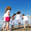 Happy child group playing on beach — Stock Photo #5969424