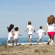 Happy child group playing on beach — Stock Photo #5969429