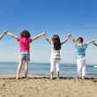 Happy child group playing on beach — Stock Photo #5969469
