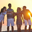 Group of young enjoy summer party at the beach — Stock Photo #5969558