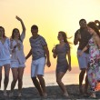 Group of young enjoy summer party at the beach — Stock Photo #5969575