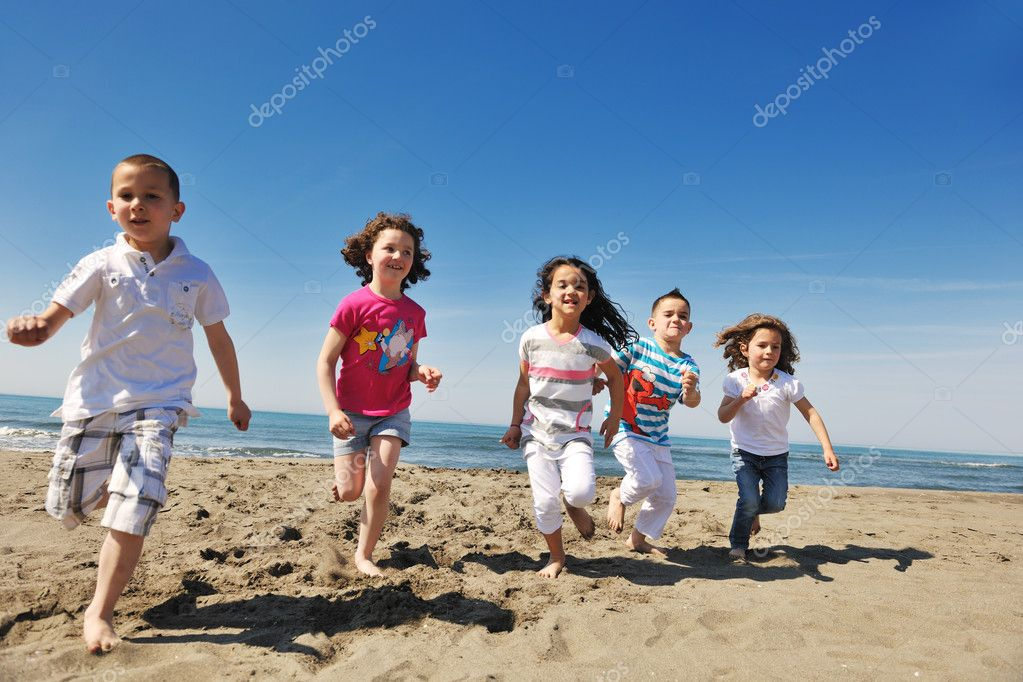 Group of happy child on beach who have fun and play games  Stock Photo #5969523