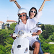 Portrait of happy young love couple on scooter enjoying summer t — Stok fotoğraf