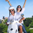 Portrait of happy young love couple on scooter enjoying summer t — Stock Photo #6012052