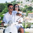 Portrait of happy young love couple on scooter enjoying summer t — Stockfoto #6012223