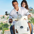 Portrait of happy young love couple on scooter enjoying summer t — Stock fotografie #6012329