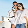 Portrait of happy young love couple on scooter enjoying summer t — Stock Photo