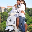 Portrait of happy young love couple on scooter enjoying summer t — Stock Photo #6012811