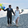 Stock Photo: Romantic beach wedding at sunset