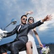 Just married couple on the beach ride white scooter — Stock Photo #6015859