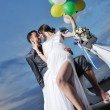 Just married couple on the beach ride white scooter — Stock Photo #6016089