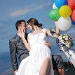 Just married couple on the beach ride white scooter — Stock Photo #6016106
