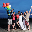 Stock Photo: Happy young group have fun on beach