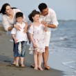 Happy young family have fun on beach — Stock Photo #6017095