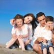 Happy young family have fun on beach — Stock Photo #6017175