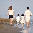 Happy young family have fun on beach — Stock Photo