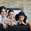 Young family at home — Stock Photo #6019393
