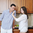 Stock Photo: Happy young couple have fun in modern kitchen