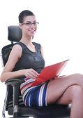 Brunette female model posing on business chair — Stock Photo