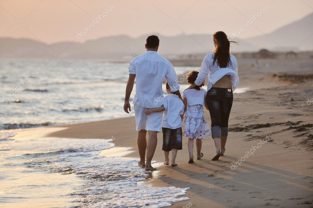 Happy young family have fun and live healthy lifestyle on beach  Stock Photo #6018337