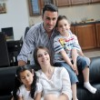 Young family at home — Stock Photo #6020065
