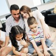 Young family at home — Stock Photo #6020347