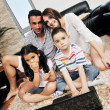 Young family at home — Stockfoto
