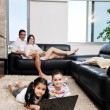 Happy young family have fun and working on laptop at home — Stock Photo #6020644