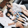 Stock Photo: Young family at home