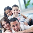 Young family at home - Foto Stock