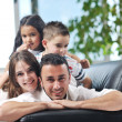 Young family at home — Stock Photo