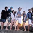 Group of young enjoy summer  party at the beach — Stock Photo #6022807