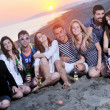 Group of young enjoy summer party at the beach — Stock Photo #6022911
