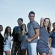 Group of young enjoy summer party at the beach — Stock Photo #6023047