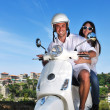 Portrait of happy young love couple on scooter enjoying summer t — Stock Photo #6023345